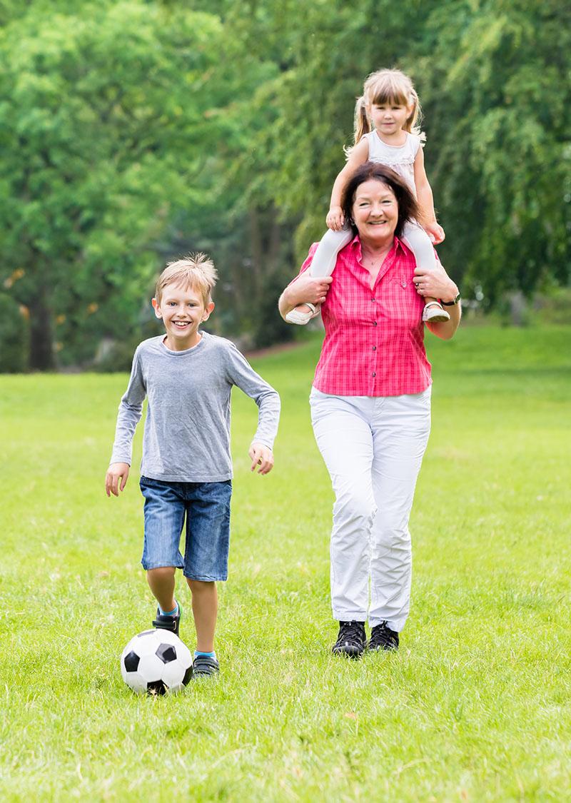 Grandparent And Grandchildren Playing Football